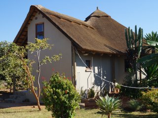 2-3 bed thatched cottage in beautiful gardens, Lusaka