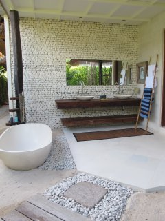 Balinese open bathroom with bath and shower