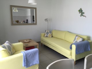 Lounge area shown with lemon covers and blue throws (changeover)