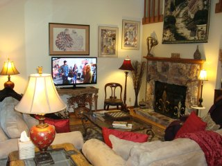 Living Room: 20' Cathedral Ceiling, Gas Log FP, 52' HDTV/DVD; Movies, Massage Chair; 2 Comfy Sofas