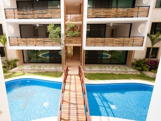 Sunny Lux condo with bikes, beach clubs, Tulum