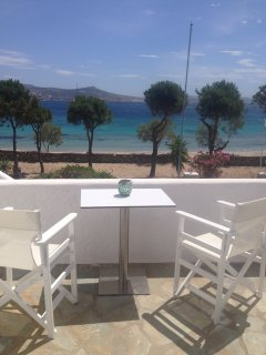 Beachfront main floor private, furnished terrace facing the sea!