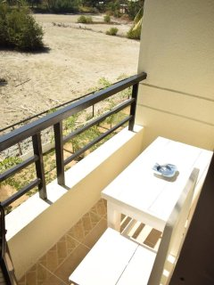 small table and chair on the balcony