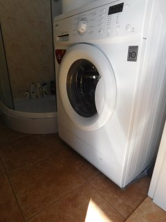 bathroom with modern LG washer