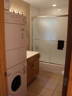 1st bathroom with shower door, tile and washer dryer for your convenience