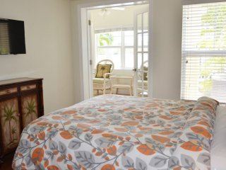 Master bedroom with TV and French doors to view of water!