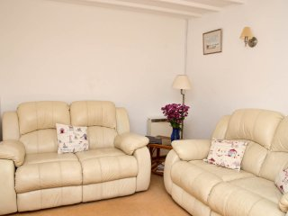 The sitting room with two comfy sofas