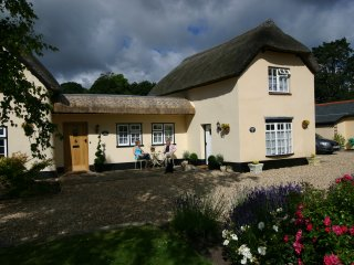 Badgers Den Thatched cottage from the front