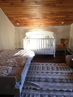 children's room with twin bed and crib