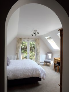 Master bedroom with Juliette balcony and views across the Shropshire Hills.