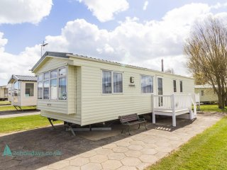 Ref 80079 Greenways 8 berth caravan at Haven Hopton near the beach.