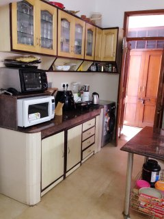 The kitchen has microwave, oven, Washing Machine, Air Fryer and coffee machine