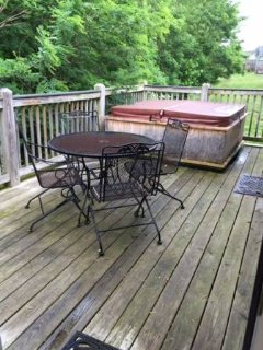Enjoy your back deck, hot tub, outdoor charcoal grill and table/chairs & umbrella.