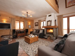 The living room is complete with comfortable sofas, log fire and flatscreen satellite TV