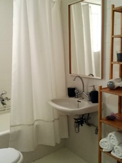 Bathroom with hairdryer, fresh towels, first aid kit, etc