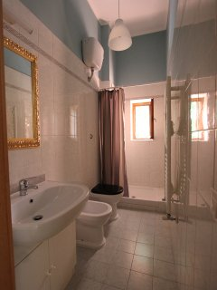 Bathroom with shower, wash basin, bidet and wc
