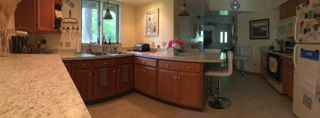 Panoramic of kitchen looking toward front door.