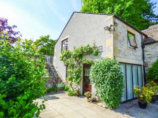 THE NOOK, stone-built cottage, open plan living area, WiFi, private garden, nr