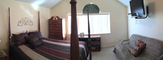 Panoramic view of Master.  Bed is flat - that slope effect is just the camera photo type.