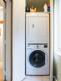 Full-size washer/dryer is convenient but out of earshot behind two doors