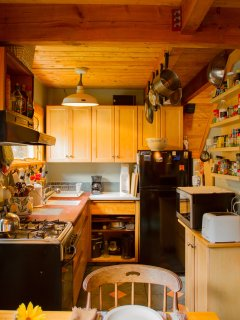 Compact but family of 5 tested kitchen has what you need...sorry no dishwasher