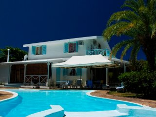 Villa with  pool located in a beautiful tropical garden close to the beach