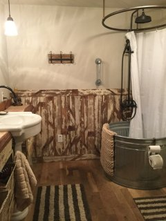 Fully renovated bathroom with rainfall shower head.  Reclaimed wood & redwood slab counters