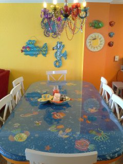 Large, fun, hand-painted dining table seats 8, in addition to 4 barstools for ample seating