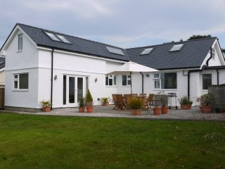 Large enclosed rear garden and patio area