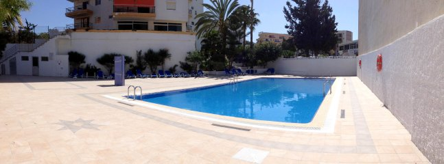 Wide and sunny pool area.