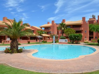 Large ground floor apartment, huge patio, communal pool