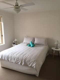 3rd bedroom with double bed.View to outdoor backyard garden