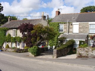 Ancarva sits amidst pretty original cottages in the village centre of Perranwell.