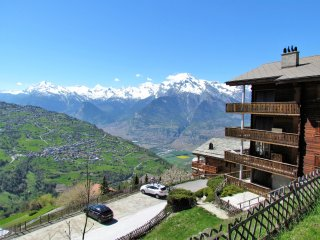 Apartment chalet block and view of the valley and mountains beyond.