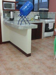 Área de cocina de Suite Familiar, capacidad 4 personas,