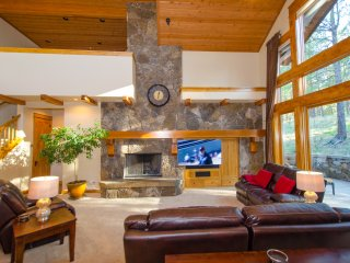 Great room featuring 65'  TV with TiVo DVR, Blueray DVD, AV System & fireplace!