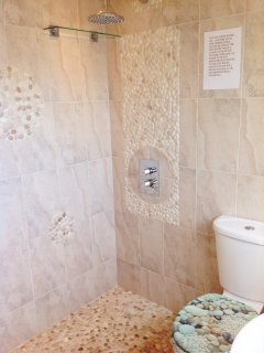 Wet room next to bedroom 3 but also  convenient for coming straight off the beach to a hot shower.