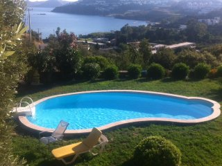 3 bedroom house with A/C, FREE wi-fi, 2 pools, roof terrace, balcony & sea view