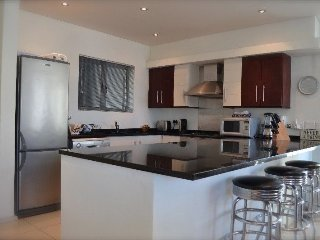 Fully equipped open plan kitchen.