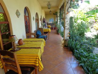 The patio of the bnb suites located in garden setting.