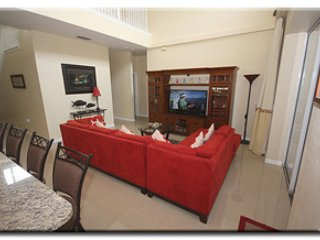 Large family room with 55' HDTV, Blue Ray DVD  & PS3