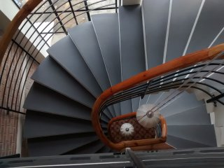 The spiral staircase that connects the floors