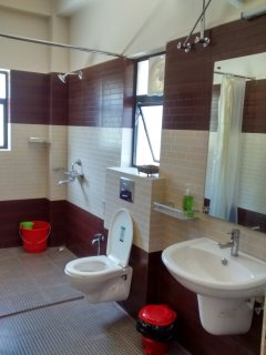 The modern bathroom attached to the Orchid Room