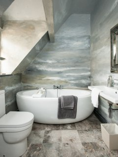 Unique bathroom with seascape mural