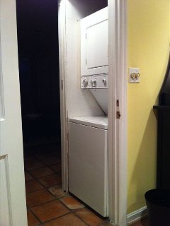 Washer/dryer, with detergent and fabric softener.