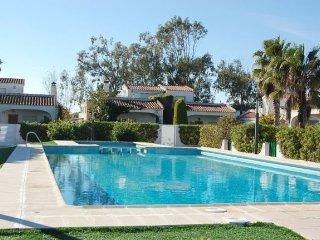 casa en urbanizacion con piscina a 50 m. playa