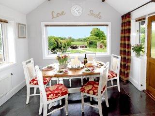 Dining room overlooking garden and meadow beyond
