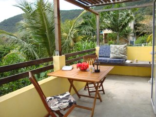 Take your meals on your private dining terrace under swaying coconut palms overlooking the mountains