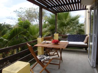 Dine outdoors on your private terrace in a private garden with views to Le Morne