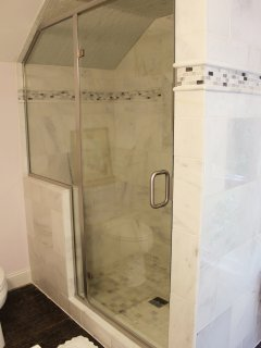 Large marble shower with bench